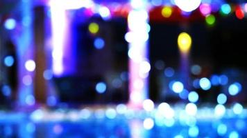 Blurred and bokeh dancing blue lights of party at luxury pool side video