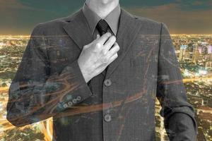 Double exposure of young businessman with cityscape background photo
