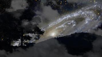 Truck view of Galaxy moving back silhouette mountain and tree with dark cloud on the night sky time lapse video