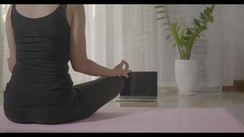 Woman teaching yoga online, meditation zen for home video
