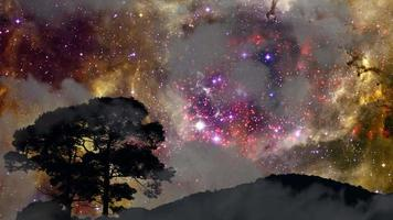 tilt view of Galaxy moving back silhouette mountain and huge tree with dark cloud on the night sky time lapse video