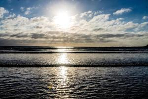 Sun setting on Opunaki Beach. Opunaki, New Zealand photo