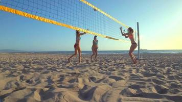 POV of a girl passing while playing womens beach volleyball. video