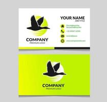 duck flying logo with business card design vector