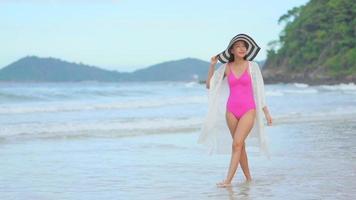 Asian woman enjoy beautiful beach video