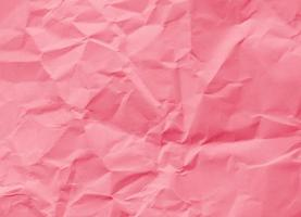 Crumpled pink paper, great background for web pages, collages, layouts photo