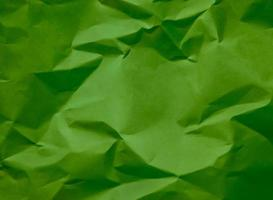 Crumpled green paper, great background for web pages, collages, layouts photo