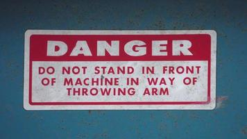 Sign on a vintage baseball pitching machine reads  DANGER do not stand in front of machine video