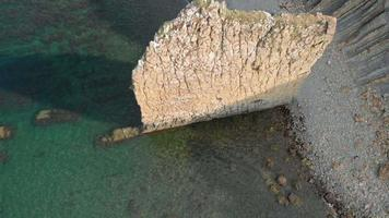 Rock in the sea Aerial shot video