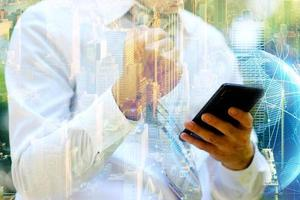businessman using a smartphone and Businessman working on digital network with double exposure photo