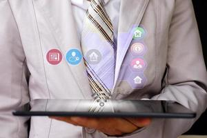 businessman holding tablet and technology network concepts photo