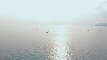 Flight over the sea with boats Aerial shot video