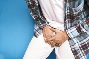 the concept of prostate and bladder problem, crotch pain of a young person photo