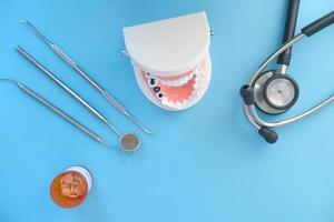 plastic dental teeth model on blue background photo