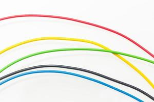 Colored wires on white background photo