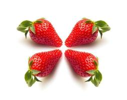 Two strawberries close up on white background photo