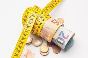 Money and dressmaker's tape measure photo