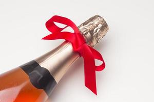 Campagne bottle with a red bow photo