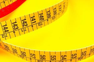Tape measure isolated on white photo