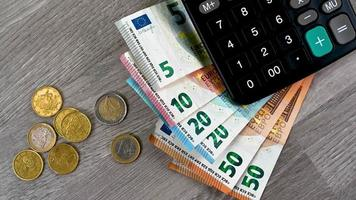 Euro banknotes of different denominations with calculator video