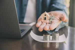 Man giving key house to customer, Business investment real estate concept photo