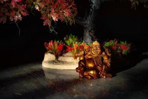Statue of laughing Buddha photo
