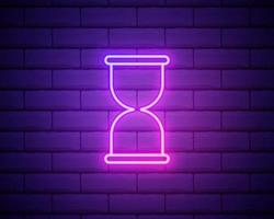 Glowing neon Old hourglass with flowing sand icon isolated on brick wall background. Sand clock sign. Business and time management concept. Vector Illustration
