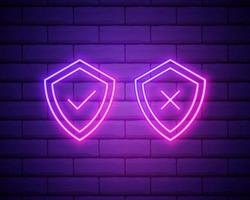 Glowing neon Shield with check and cross mark icon isolated on brick wall background. Protection symbol. Security check Icon. Tick mark approved icon. Vector Illustration