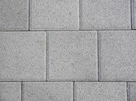 Beton tiles on the sidewalk as a texture photo