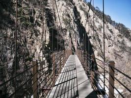 Suspension bridge in the beautiful mountains Seoraksan. Front view photo