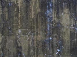 Old beton wall as a background texture wit brown and blue color photo
