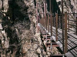 Suspension bridge in the beautiful mountains Seoraksan. Side view photo
