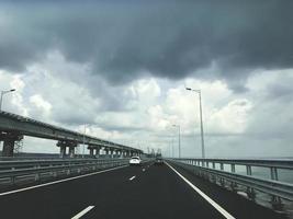 Crimean bridge. New highway on the bridge with unloaded traffic photo