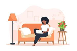 Young woman sitting on sofa and working on laptop from home vector