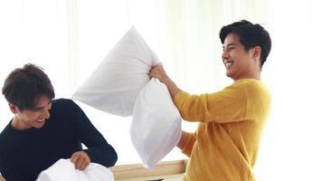 Asian Couple Enjoying a Pillow Fight video