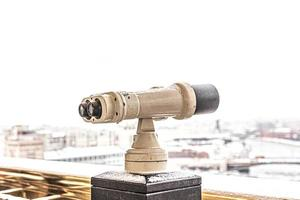 Coin-operated binoculars on the observation deck overlooking the city photo