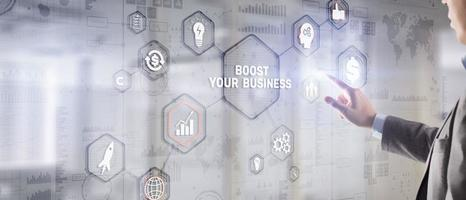 Boost Your Business 2021. Businessman touching finger virtual screen photo