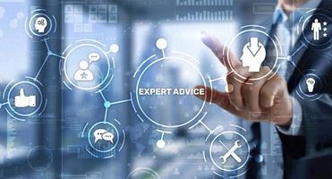 Expert advice. Businessman hand touching inscription on virtual screen photo