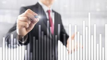 Business and finance graph on blurred background. Trading, investment and economics concept. photo