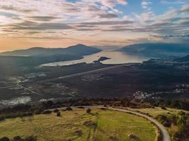 Aerial photography view over green field and Tivat Bay and airport in Montenegro photo