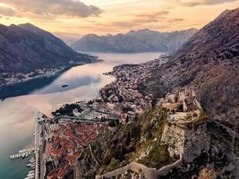 San Giovanni Castle - St. Ivan Fortress and Old Town of Kotor in Montenegro in the Bay of Kotor. View from above by drone. photo