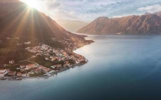 Aerial view of Town Prcanj in Kotor bay on sunset, sunshine over city in Montenegro photo