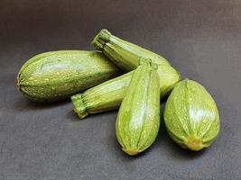 zucchini of natural origin to prepare vegetarian food photo