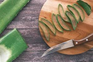 Close-up of fresh aloe vera sliced on a chopping board photo