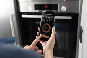 Close up smartphone with kitchen control photo