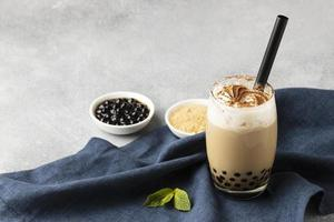 Composition with delicious traditional Thai tea background photo