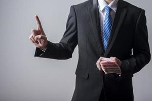 Business man holding China money photo