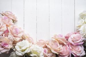 Wedding flower background on white wood photo