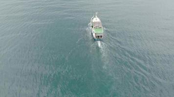 white boat sailing in the blue sea Aerial shot video