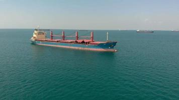 Cargo ship at sea Aerial shot video